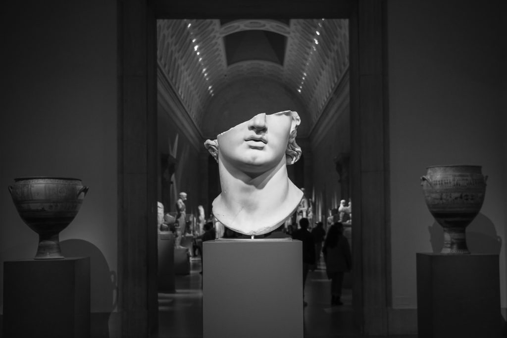 Image of marble bust in a museum. Photo by Liza Rusalskaya on Unsplash